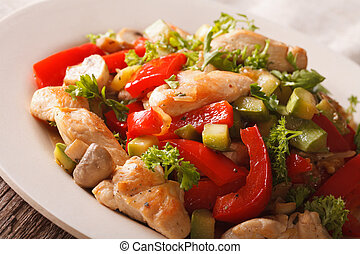 Chicken saute with mushrooms and vegetables close-up...