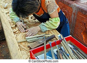 Wood carver at work in Xi\'an, China - Wood carver working...