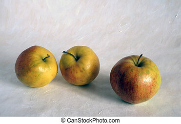 three old apples on painted background