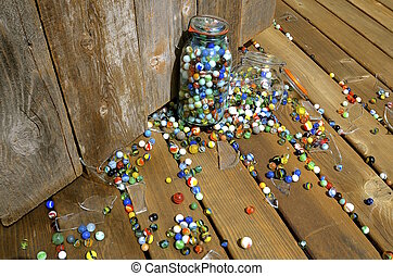 Broken jar of marbles