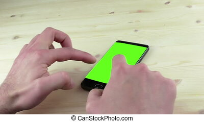 man hands using a smart phone for write text messaging with...