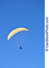 Paragliding - Some people doing paragliding in the sky