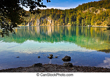 alpine mountain lake - view from the shore to a beautiful...