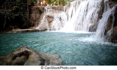 water - Deep forest Waterfall in Kanchanaburi, Thailand