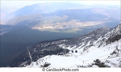 cable - Cable car up to snow mountain in highest mountain...