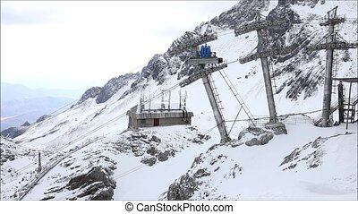 cable car - Cable car up to snow mountain in highest...