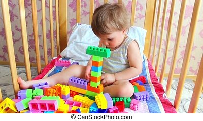 Kid building spaceship with lego bricks - Kids playing...