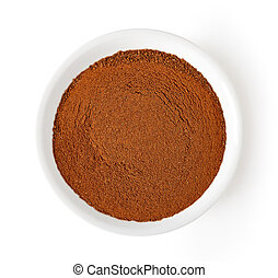 bowl of cinnamon powder isolated on white, from above