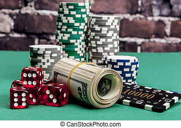 Chips and Money - Dice, money and chips on green table