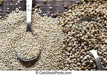 buckwheat and quinoa seeds - high-angle shot of some spoons...