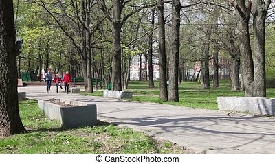 Kids running on the alley in park - Happy kids running on...