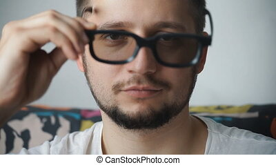 portrait of a man dressing 3D glasses and smiling - close-up...