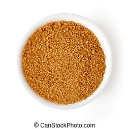 Bowl of brown sugar isolated on white, from above