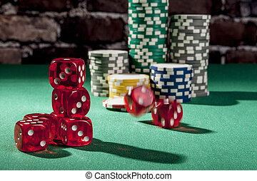 Rolling Red Dice - Dice and chips on green table with shadow