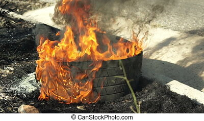 Tire Burning on Side of Road Pan - Burning tire on the side...
