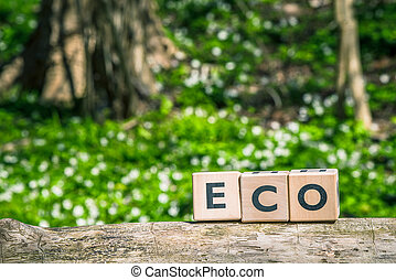 Eco sign on a wooden branch