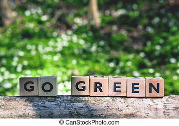 Go green message in a forest