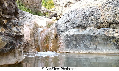 stream in rock with stone baths - mountain brook machined...
