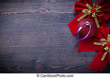 Christmas red bows ball on wooden board holidays concept