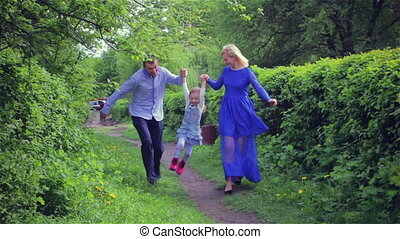 Happy young family spending time outdoor on a summer day...