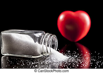Red Heart and Salt - Heart and salt isolated on black...