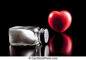 Heart and Salt - Heart and salt isolated on black background...