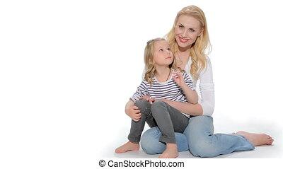 Little girl sits on mother knees - Little caucasian girl...