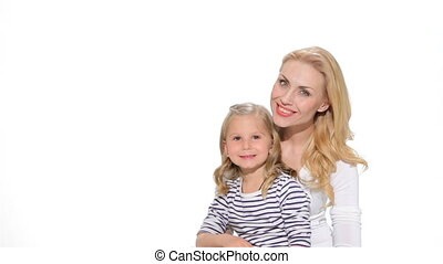 Little girl and mother make silence gesture - Blond little...