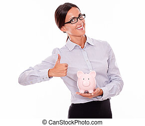 Satisfied businesswoman holding pink piggy bank