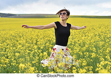 Young woman enjoying freedom in the outdoors