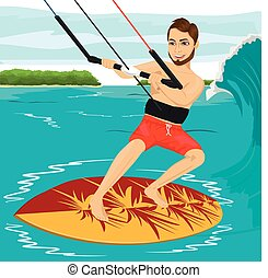 Male kiteboarder enjoys surfing waves with kiteboard - Male...
