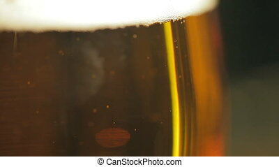 Beer bubbles in a glass - A glass of fresh light beer There...