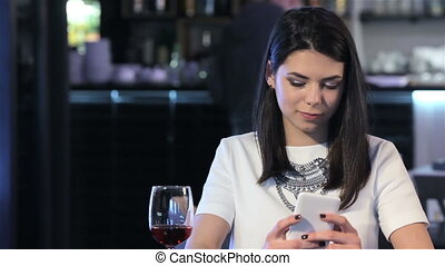 Woman looks at her smartphone