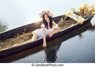 Fantasy art photo of a beautiful lady lying in boat - Young...