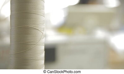 A skein of thread on a sewing machine - A close-up of a coil...