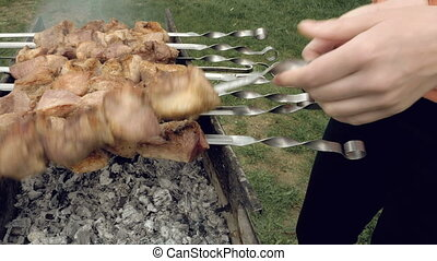 Barbeque skewers with meat cooking on brazier - Barbeque...