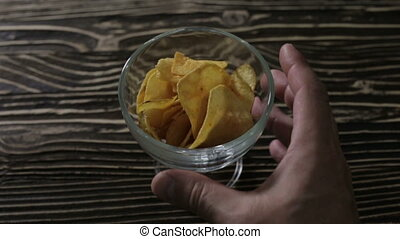 Chips are in a glass vase on the table