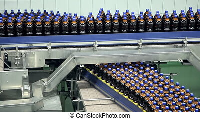 Bottles are moving on the tape conveyor