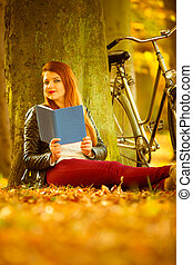 Beautiful girl is reading under the tree - Nature, outdoor...