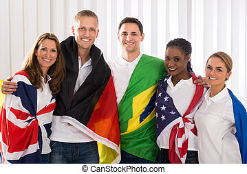 Happy People With Flags From Different Countries - Group Of...
