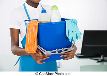 Janitor Holding Cleaning Equipments - Close-up Of A Female...