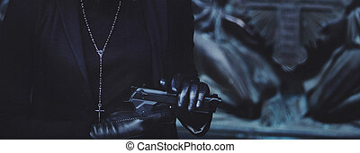 close-up hands of girls in black leather gloves, grip gun -...