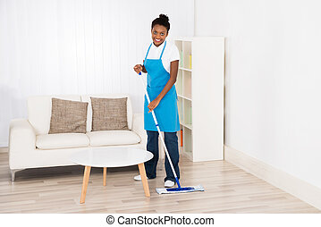 Female Janitor Mopping Floor - Young Happy Female Janitor...