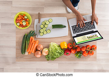 Woman Looking At Recipe On Laptop