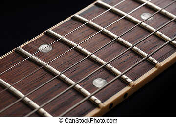 Guitar fingerboard close up on dark background