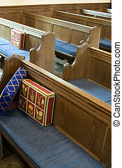 church pews - rows of wooden church pews with prayer...