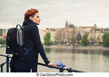 Female tourists enjoying the view of the city - Young female...