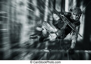 Army Soldier in Action Jumping Over Fallen Tree Military...