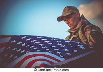 Army Veteran with USA Flag - Young Army Veteran with...