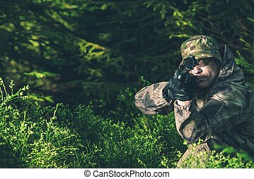 Forest Hunter Poacher with Rifle Spotting Some Deers